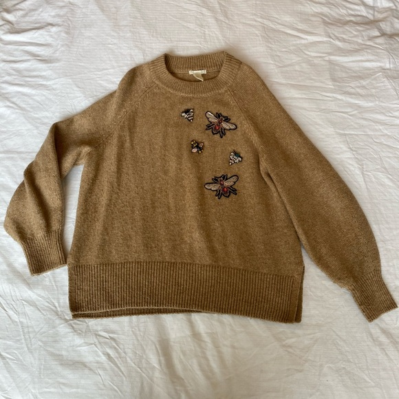 Sweater with detailed patches